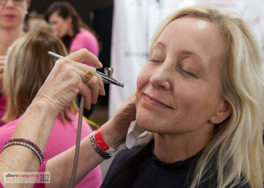 "Dinair airbrush ""air kisses"" for the 64th Primetime Emmys"
