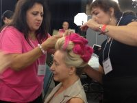 The pink Dinair Emmy updo is coming together!