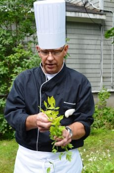 Chef Lou Keifer in his restaurant garden at the Bar Harbor Inn